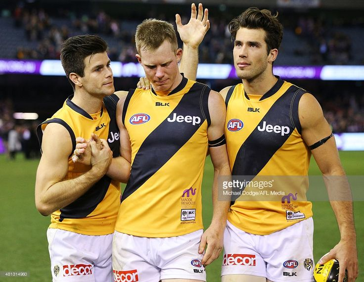 Jack Riewoldt of the Tigers (C) walks off in tears with Trent Cotchin (L) and Alex Rance during the round 16 AFL match between the St Kilda Saints and the Richmond Tigers at Etihad Stadium on July 19, 2015 in Melbourne, Australia.