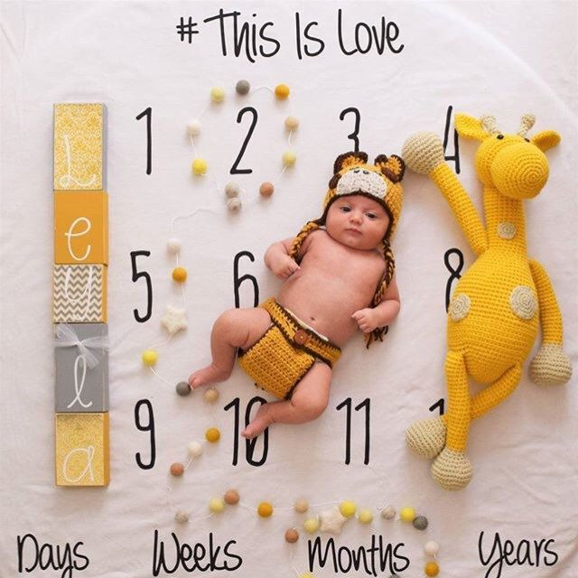 Such a cute milestone blanket makes the perfect baby shower gift!