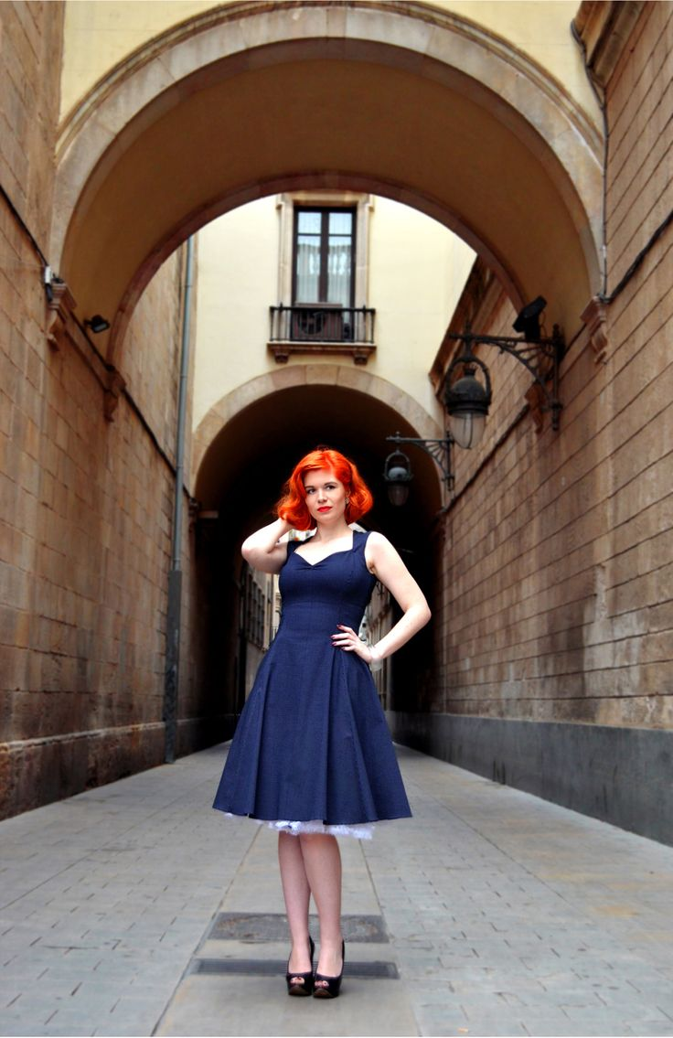 50s inspired flared dress in navy blue with white polka dots.    http://ow.ly/MbM5c