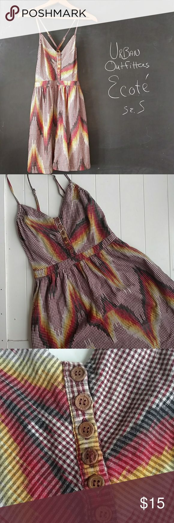 Urban Outfitters Ecote Sun Dress Sz S Urban Outfitters Ecote sun dress.  Sz S   Rust, yellow, black colors in checked pattern.  Looks like fire! Has two pockets!  Bust 28-32 in.  Can stretch to 34 in. Waist 25-28 in. Skirt length is above knee.  Dress measures approximately 33 in.  Adjustable shoulder straps. Cotton material.  Smoke and Pet Free environment.  Very good Preowned Condition.  Washed a handful of times. Urban Outfitters Dresses