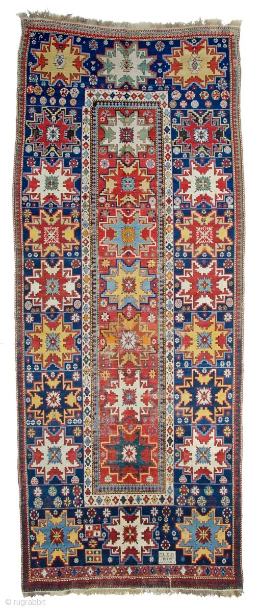 Lot 138: Lesghi star long rug inscribed and dated 1313, 13ft. x 5ft. 4in. 395 x 163cm, Caucasus end 19th century, Condition: good, some areas low pile, some reweaves and repairs, some abrasion Wool warp, wool ...