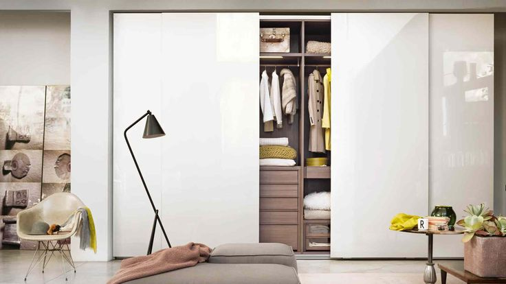 LEMA | Prima Wardrobe by Officinadesign Lema featuring doors without visible handles. Customisable in depth, it also features wide-ranging internal equipment to offer multiple combinations for any need of order.