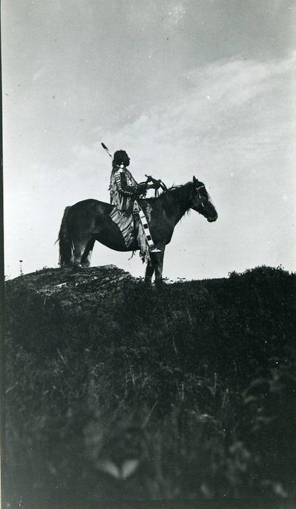 Blackfeet man on horse, name and date unknown.