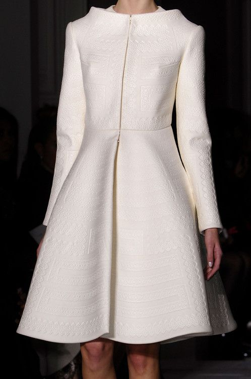 Valentino 2014. Absolutely smashing! The color, the fabric design, the styling...a real statement coat!!!