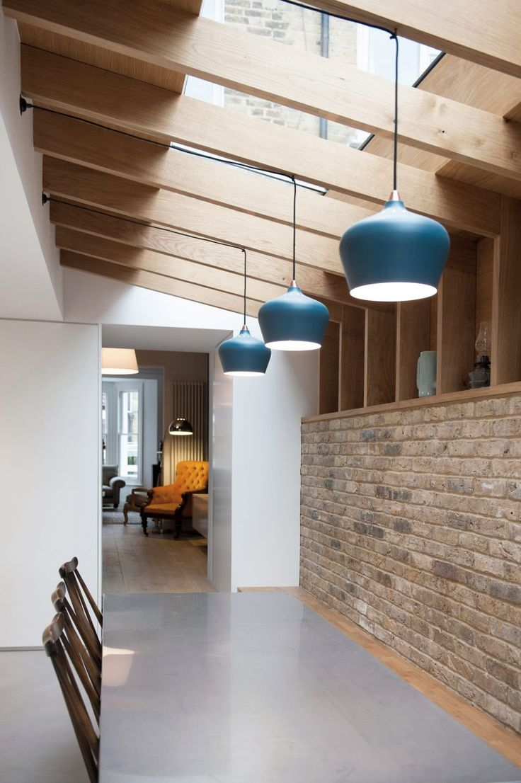 """Seamless skylights, concrete floors, exposed brickwork, projecting glass box, whitewashed ash slats and oak ribs create an enthralling new take on a period house,"" they added."