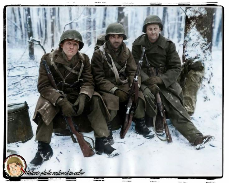 Slightly wounded infantrymen of Company 'I', 328th Infantry Regiment 26th Division await evacuation from the forward area near Wiltz, Luxembourg. January 27, 1945 Left to right: TEC/5 Harrison Miller of Riverside, California; PFC A.E. Cavolio of Schenectady, New York and PFC Claude Gapland of Mansfield, Kentucky. Half their Company was wiped out during the bitter fighting. (Colorised by Johnny Sirlande from Belgium) https://www.facebook.com/Historicphotorestoredincolor…