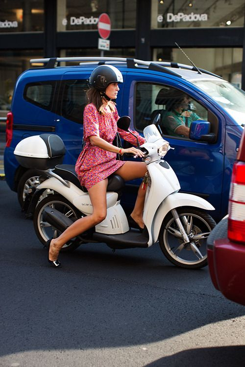 on the road…  look at them legs, love the white vespa and her dress is so pretty!