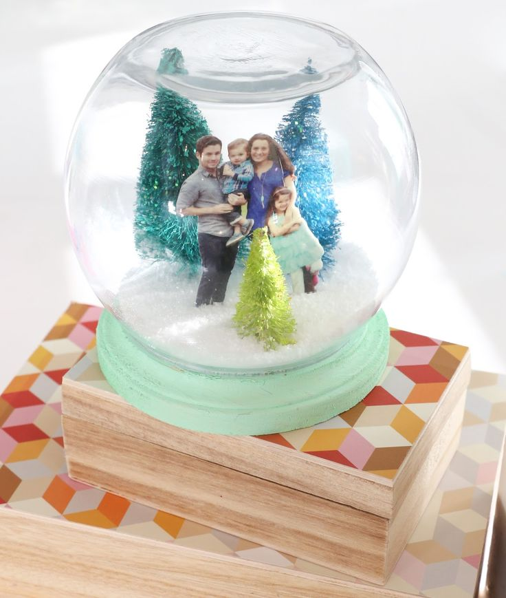 A DIY snow globe using a shrinky dink family photo inside! How fun! This would make a great Christmas gift.
