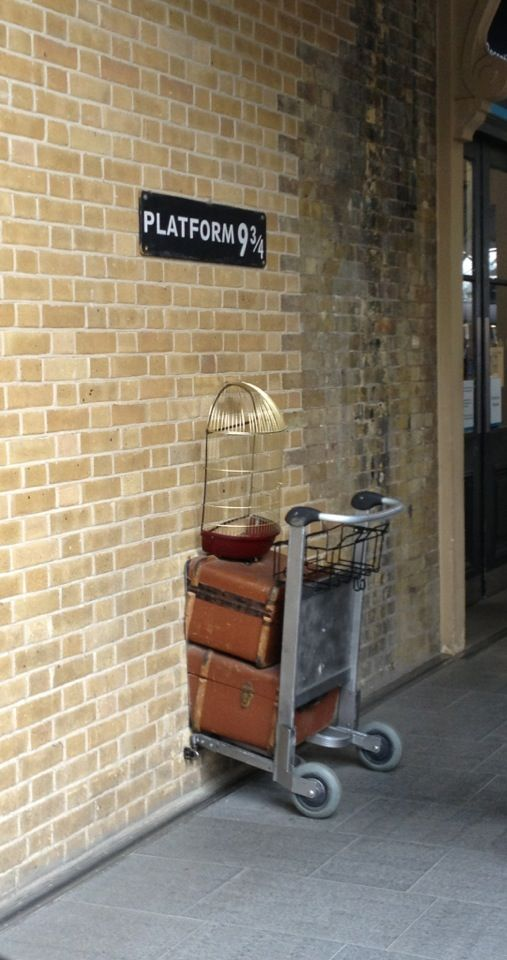 Mi favorite place in London. King's Cross Railway station is a major London railway that was opened in 1852. King's Cross is featured in the Harry Potter series by J.K. Rowling. The Hogwarts Express uses a secret platform, 9 3/4, to transport students to Hogwarts.  King's Cross has since placed a cast iron 9 3/4 sign  on the wall against where the movie was filmed with part of a luggage trolley under the sign.