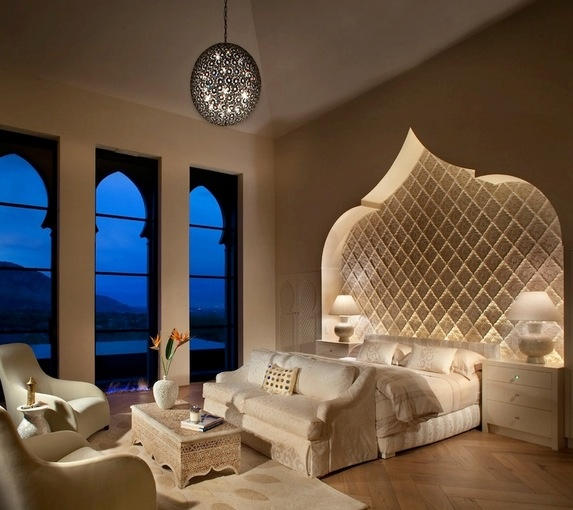 Love the idea of a couch in front of the bed...like a foot board almost. And look at that view!