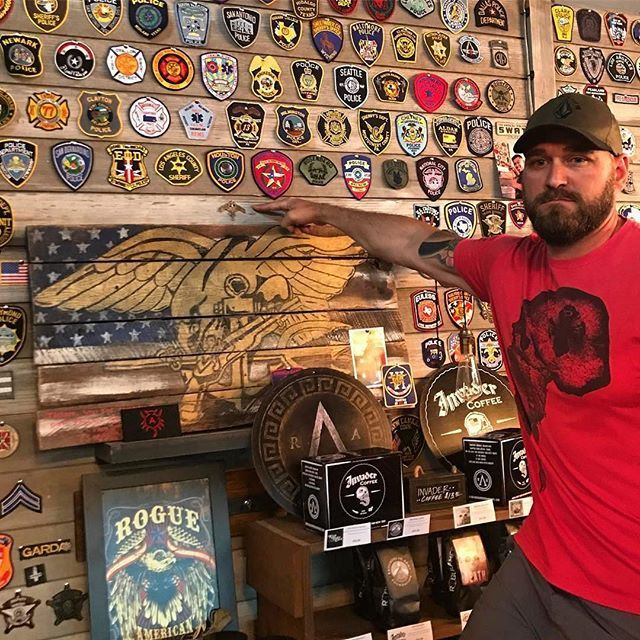 Repost from @rogueamericanapparel Real Things. Our brother, @joshhonsberger pinned the new Marine Raider Insignia on our wall today. This is the fist and very special to us because Josh has been rolling with us since day 1 and came in and  hand pinned it himself. We are honored @joshhonsberger #USMC #MARSOC #raiders #Marines #America #raanation #standforsomething