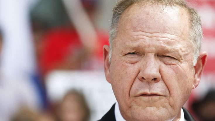 Alabama Chief Justice Roy Moore was ousted on ethics charges in 2003 for defying a federal court order. On Wednesday he faces trial for defying the U.S. Supreme Court's same-sex marriage ruling.