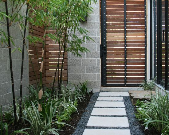 Interesting: notice the block wall isn't continuous, it's broken up by the corner metal/wood wall material. Cohen Residence, http://www.houzz.com/projects/56464/Cohen-Residence#