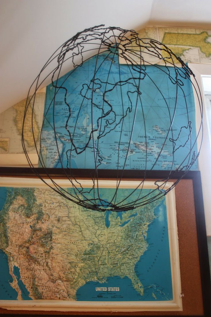 Wire frame world globe and framed maps