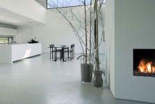 Gietvloer, met mooie betonnen afwerking en mooie haard