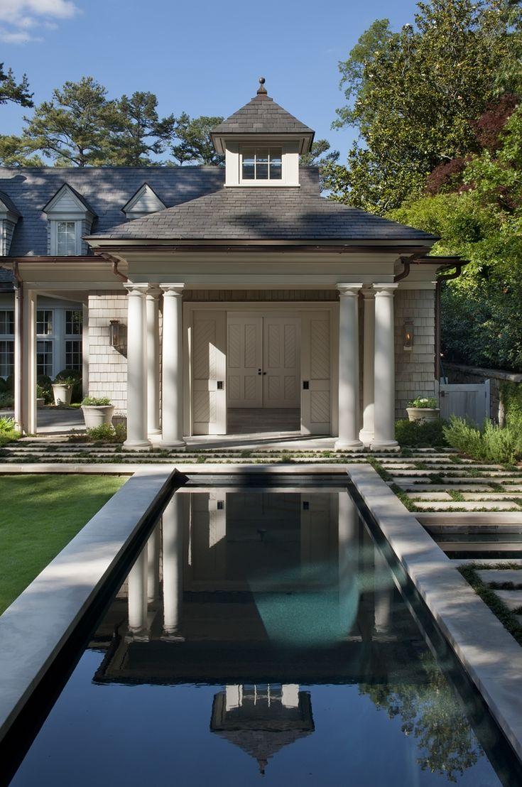 Lap pool in garden by Howard Design Studio.