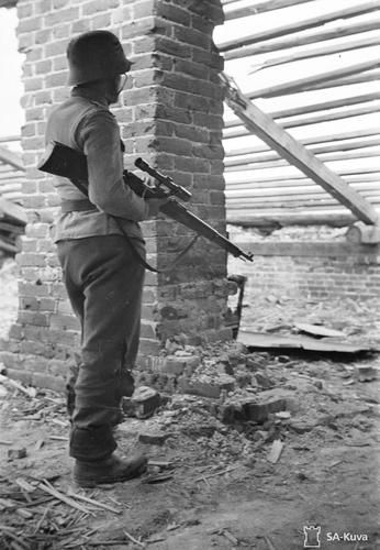 5th company sniper, private Vähätörmä in one of his regular stalking positions in the attic of a hospital building at the sector of 2nd Battalion, 33rd IR, 6th Div. Poventsa (Povenets), May 18, 1944.