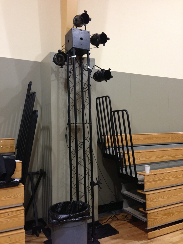lighting truss sits behind chairs facing stage. Black Bedroom Furniture Sets. Home Design Ideas
