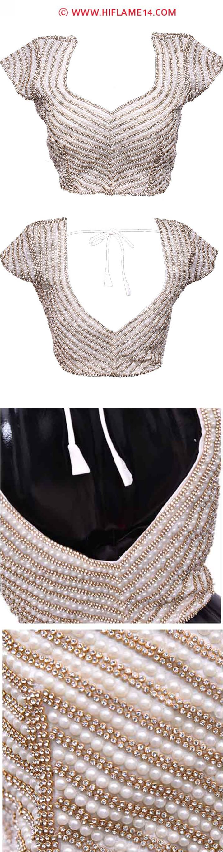 Classy Off White Ready to Wear Blouse   Make a trendy style statement when you adorn this glittering white ready to wear blouse. This off white ready to wear blouse is enhanced with glittering white stones and pearls with a unique pattern neck. Pair this unique collection for your evening and cocktail parties and rock in your occasion.