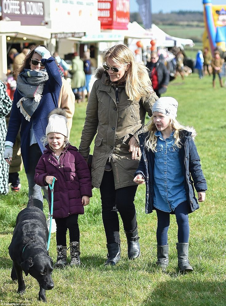 Autumn Phillips (centre) brought her daughters Isla (left) and Savannah (right) and their black Labrador to the point-to-point races at Didmarton in Gloucestershire