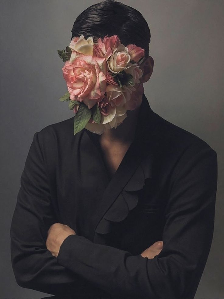 man with flowers on his face