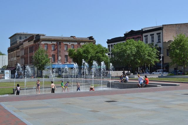 Family fun splashing in the fountain at Ellis Square, right across from City Market #savannahfun #family