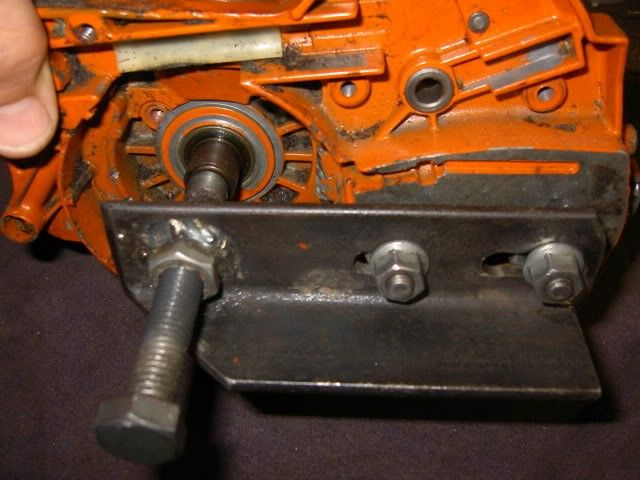 Chainsaw Case Splitter by SkippyKtm -- Homemade case splitter intended for a Husqvarna chainsaw. Fabricated from angle iron and hardware. http://www.homemadetools.net/homemade-chainsaw-case-splitter-2
