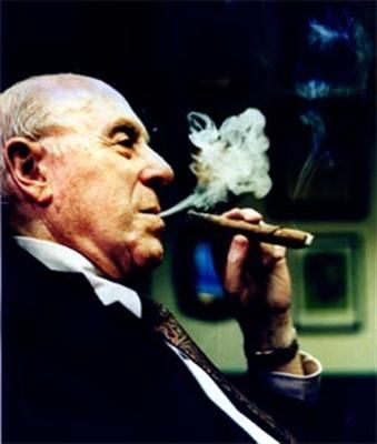 Arguably one of the greatest coaches in NBA history, Red Auerbach was the mastermind behind the Boston Celtics dynasty. He also, was an excellent General Manager drafting the likes of Larry Bird and Kevin McHale. A trademark of Red would be smoking a cigar when he knew his team have won.