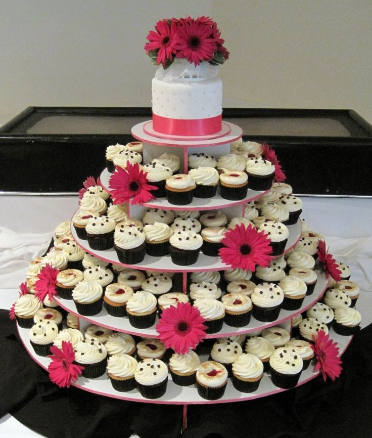 Pink, black, and white cupcake wedding cake.