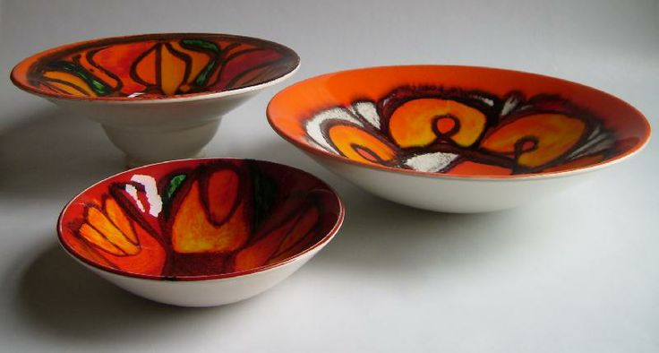 Back left, footed bowl  shape number 76 painted by Julia Wills in 1971 or 72.  Right, shape number 57, 27cm diameter, painted by Anne Godfrey between 1968 and 1970. Front left,  shape number 56, painted by Mary Albon between 1970 and 1972