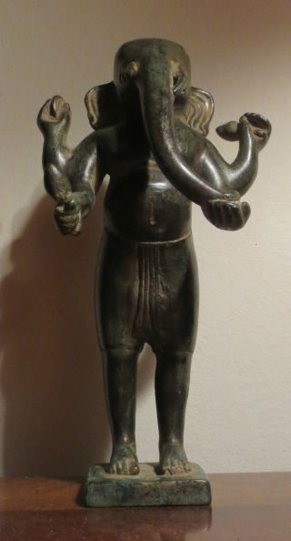 Image from http://ancientpoint.com/imgs/a/f/f/g/d/bronze_statue_of_khmer_standing_ganesh_from_cambodia_1_thumb2_lgw.jpg.