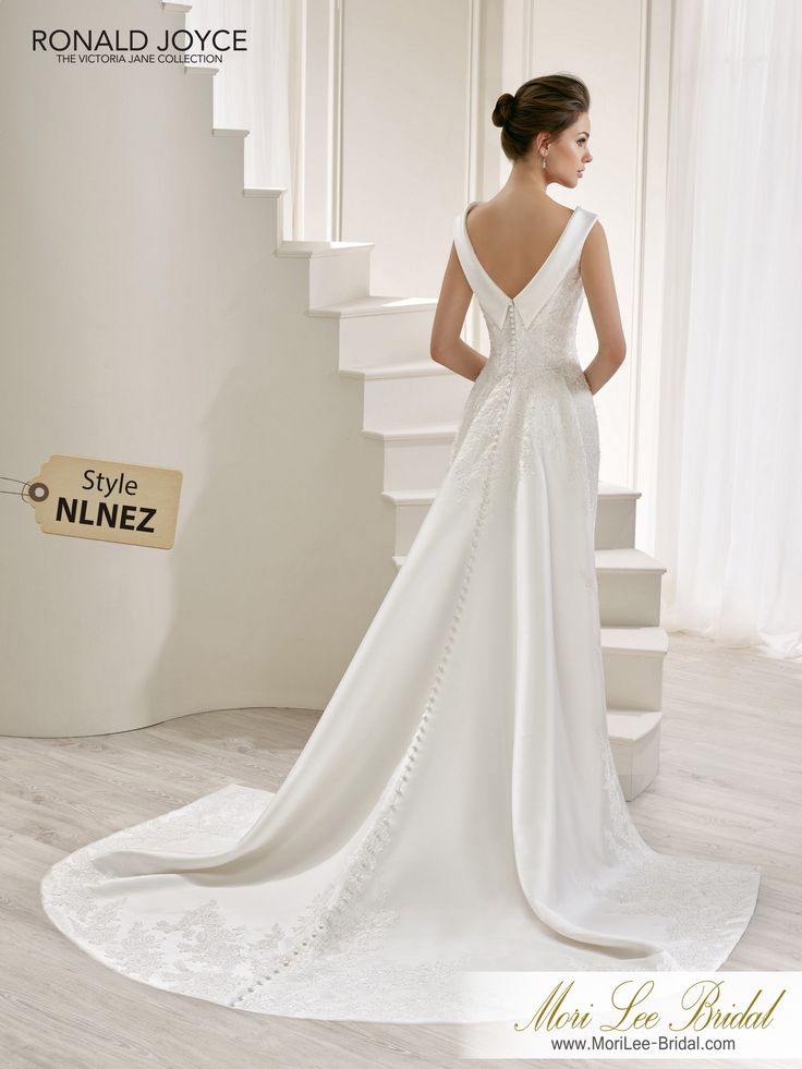 Style NLNEZ LUCIAA MIKADO DRESS WITH A STATEMENT HIGH NECKLINE, LACE APPLIQUES, V-BACK AND A UNIQUE TRAIN. PICTURED IN IVORY.COLOURSIVORY, WHITE
