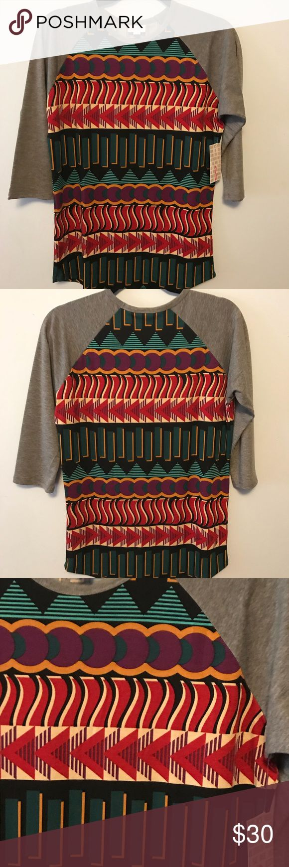 LuLaRoe Randy At LuLaRoe, comfort is key and we often liken our dresses and skirts to a simple t-shirt in terms of their wearability and comfort. With LuLaRoe's Randy shirt, we have a t-shirt to offer. This unisex knit shirt resembles a baseball T with its raglan, mid-length sleeves in a contrasting, patterned fabric. It is everything a t-shirt should be: stylish, easy, and comfortable. LuLaRoe Tops Tunics