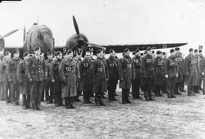 East Wretham, second base of the 311 (Czechoslovak) Bomber Squadron. Year 1941. East Wretham, druhá základna 311. cs. bombardovací perute. Rok 1941. 1. VALACH Karel, 2. HORÁK Josef, 3. KONŠTACKÝ Vilém, 4.FILLER Josef, 5. ANDERLE Leo, 6. VNOUCEK Jindrich, 7. CTVRTLÍK Miroslav, 8. BERNÁT Josef, 9. SLÁNSKÝ Vladimír, 10. BREITCETL Jindrich, 11. KIRCHSTEIN Alois, 12. KOŠEK Ludvík, 13. ROZUM Alois, 14. ŠTUDENT Václav, 15. KORDA Václav, 16. ZAPLETAL Milan, 17. NEDVED Vladimír, 18. JEDOUNEK Arnošt…