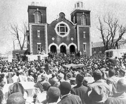 Thousands of civil rights supporters gather outside a chapel in Selma, Ala., on March 21, 1965, the start of a five-day, 50-mile march on the Alabama state Capitol at Montgomery. The march will be led by the Reverend Dr. Martin Luther King, who spoke at this church service preceding the march. Supporters of black voting rights will march from Selma to Montgomery to protest the killing of a demonstrator by a state trooper and to improve voter registration for blacks, who are discouraged to…