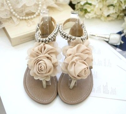 DIY - shoe decor : An idea is to change the sandals that you have like this by pinning the flowers (or whatever it is you want). By pinning it on top of the sandal you can have several different styles just from one pair :)