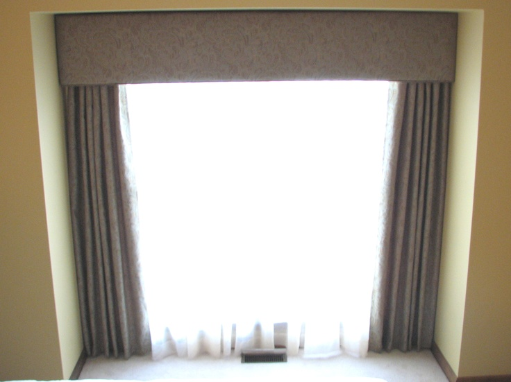 Bay Window Drapes Coordinated With Sheers On A Traverse