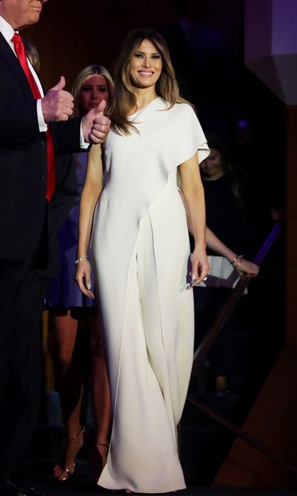 President-elect Donald Trump's wife made her grand debut as the country's new first lady on November 9 sporting a chic ensemble by all-American designer, Ralph Lauren. Melania exuded elegance donning a one-shoulder silk crepe jumpsuit by the designer.
