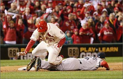 The Cardinals' Allen Craig trips over Will Middlebrooks as he tries to score from third in the ninth inning of Game 3. Middlebrooks was called for interference and Craig was awarded home.