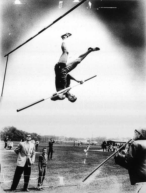 Photographer/Creator  Edwin Stein  Collection  1962  Publisher  Wisconsin State Journal  Caption/Description  Pole vaulter is in the air when his fiberglass pole breaks.