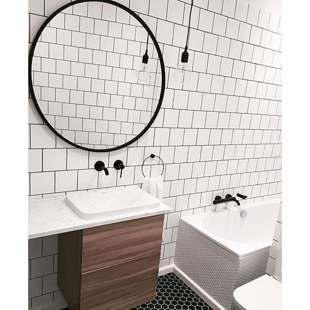 Gorgeous Black, White And Walnut Bathroom With Oversized Round Mirror: Umbra  HUB Mirror.