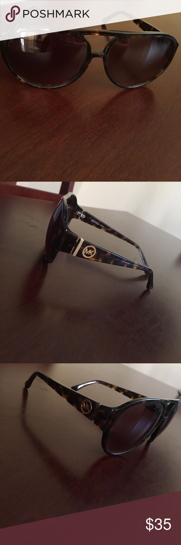 Michael Kors sunglasses Women's Michael Kors sunglasses-no case. Missing a little gold strip on the right hand side. (Refer to the photos) Michael Kors Accessories Glasses
