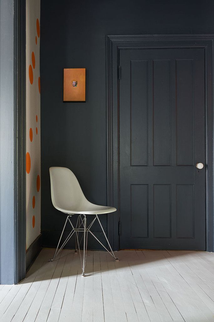 Painting out the trim and doors in the same color is a unifying modern approach.