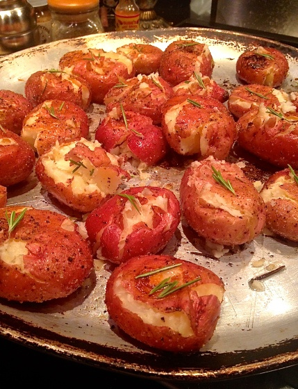 rosemary roasted new potatoes!  So easy and decadent!  1 1/2 pounds small new red potatoes, washed and dried 1/4 cup extra-virgin olive oil 4 sprigs fresh rosemary, take herb off the stem 3 tbsp bobby's butt rub salt and pepper to taste
