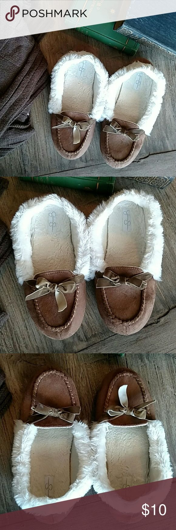 Jessica Simpson Slippers Furry slippers by Jessica Simpson. Light padding to inside and hard soles on bottoms. White inner and brown outer. Ribbon bow on top. Gently used condition. Jessica Simpson Shoes Slippers