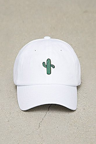 A dad cap featuring an embroidered cactus on the front and an adjustable back.