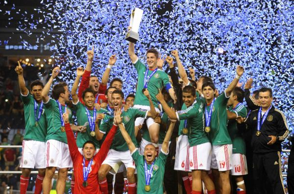 The Mexican team celebrates with their trophy after winning the CONCACAF Olympic qualifying finals soccer match against Honduras in Kansas City, Kansas April 2, 2012.