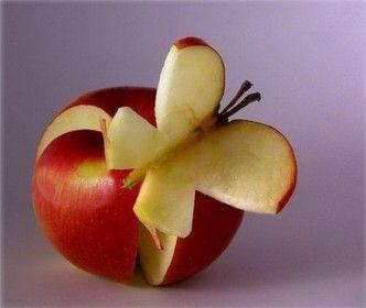 Creative Food Art. Apple posing as butterfly.
