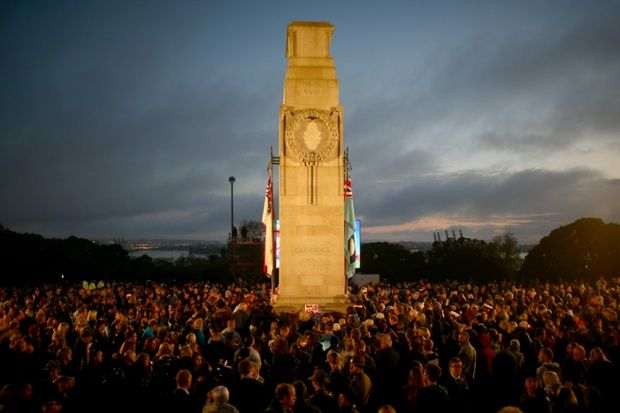 People gather at the cenotaph at the War Memorial Museum in Auckland, New Zealand to mark the 99th anniversary of ANZAC  Day when allied First World War forces landed on the Gallipoli Peninsula.