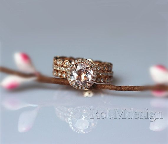 This one would also be a great Christmas present..... Halo Wedding Ring set in 14K Rose Gold Round by RobMdesign on Etsy